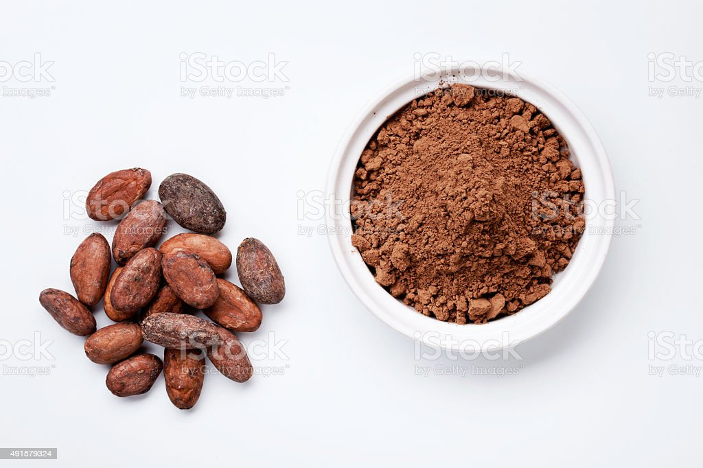 Cocoa Beans and Grounded Cocoa stock photo