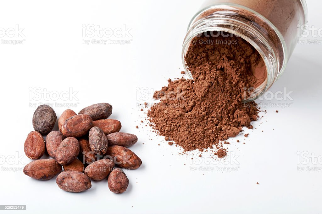 Cocoa Beans and Jar of Cocoa Powder stock photo