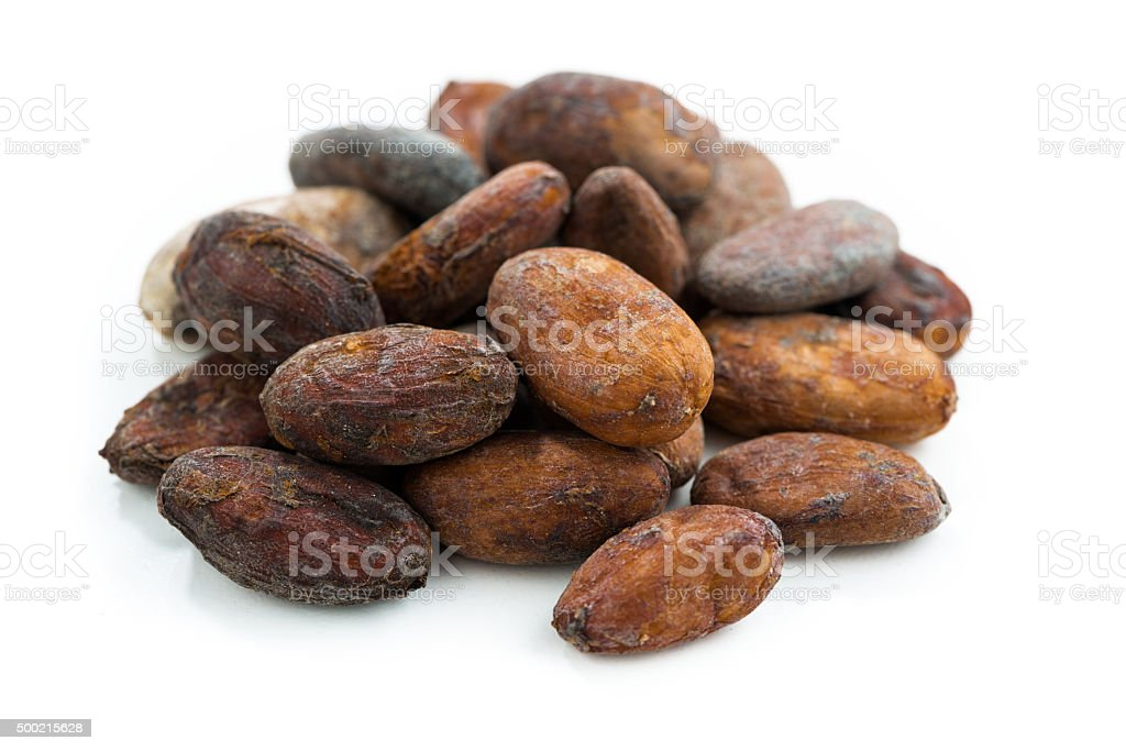 cocoa beans on white background, isolated stock photo