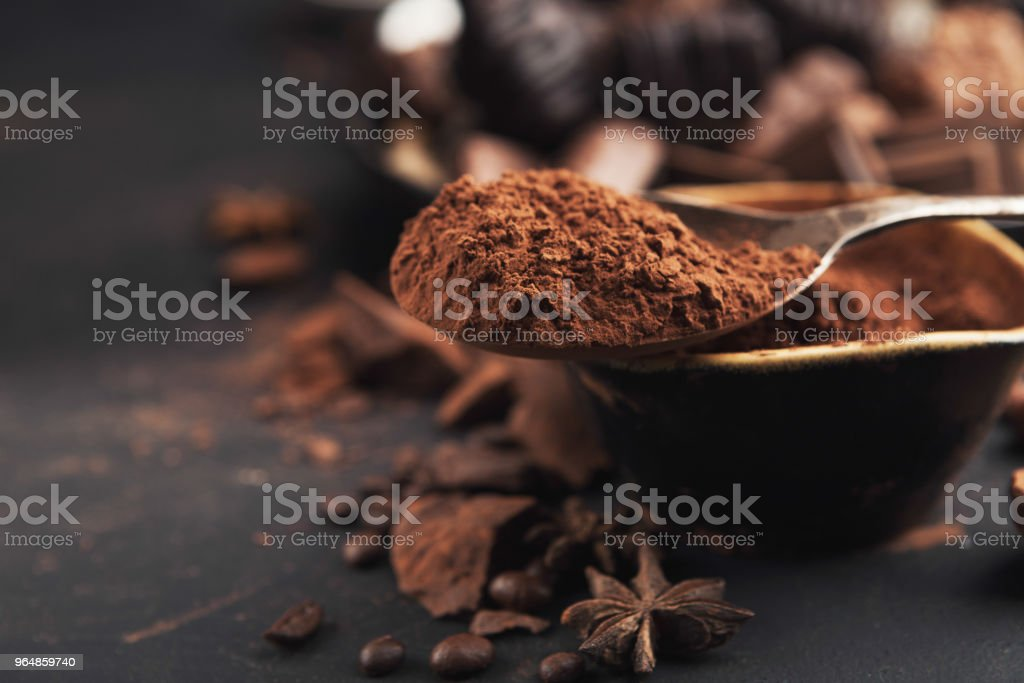 Cocoa bowl and crushed chocolate pieces on gray background royalty-free stock photo