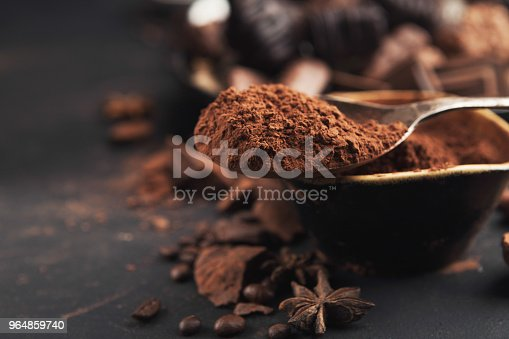 istock Cocoa bowl and crushed chocolate pieces on gray background 964859740