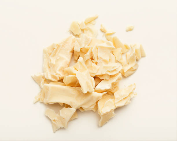 Cocoa butter isolated on white Pieces of cocoa butter isolated on white background. Heap of white chocolate, cutout theobroma stock pictures, royalty-free photos & images