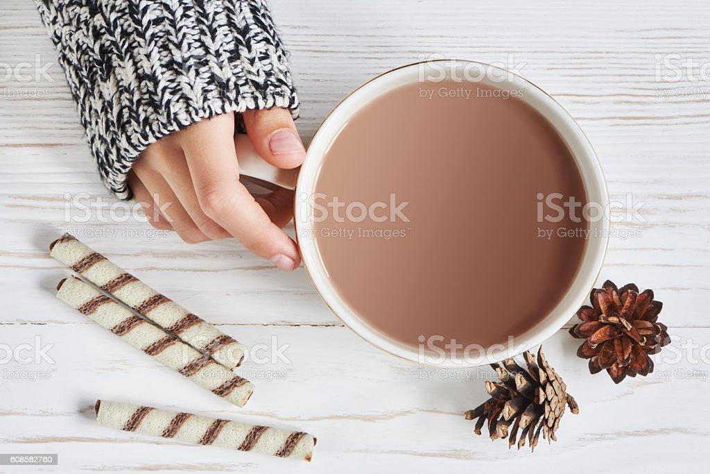 Cocoa cup and woman hand - foto de acervo