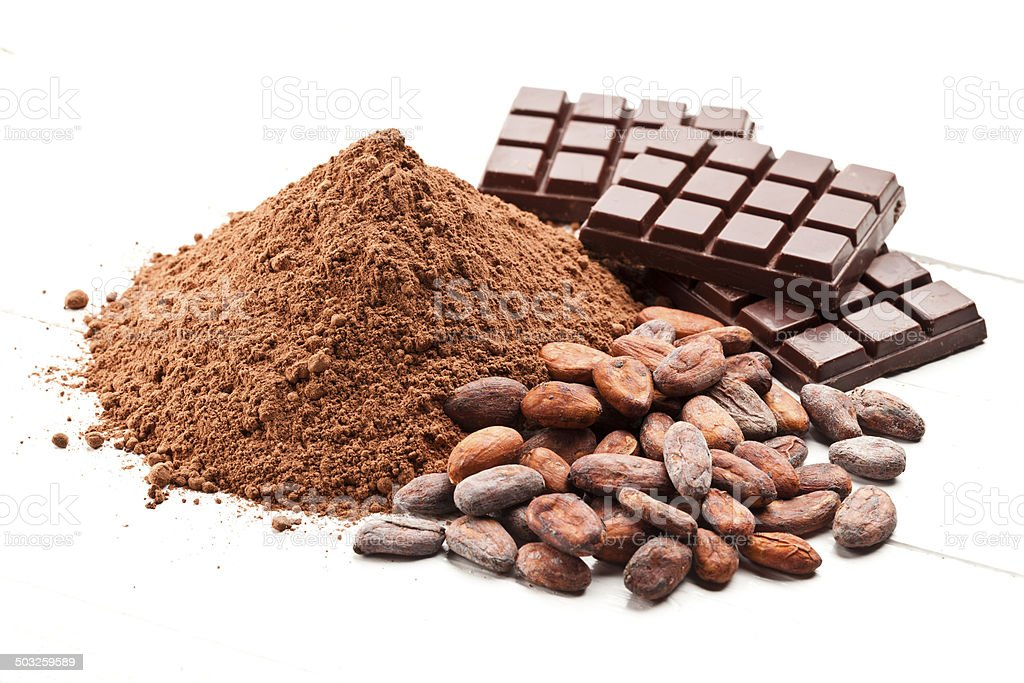 Cocoa differents presentations, ground cocoa, cocoa beans and candy bar royalty-free stock photo