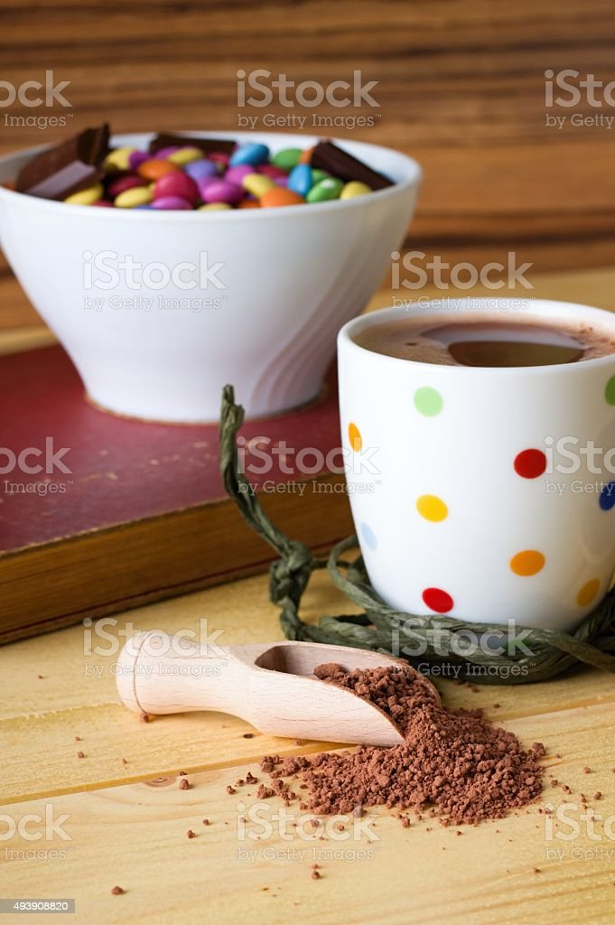Cocoa drink and bowl with sweets stock photo