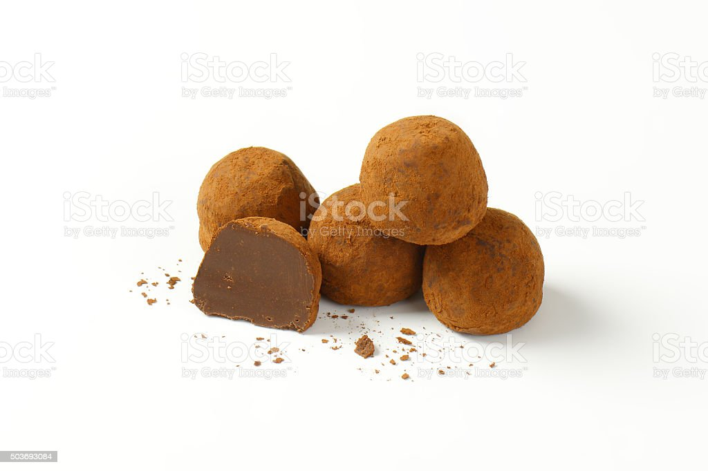 Cocoa dusted chocolate truffles stock photo