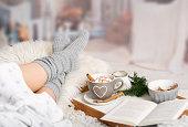 istock cocoa, hot chocolate, book, cosy in the wintertime 1284880867