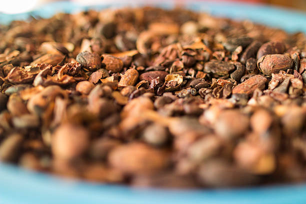 Cocoa Nibs on a blue platter stock photo