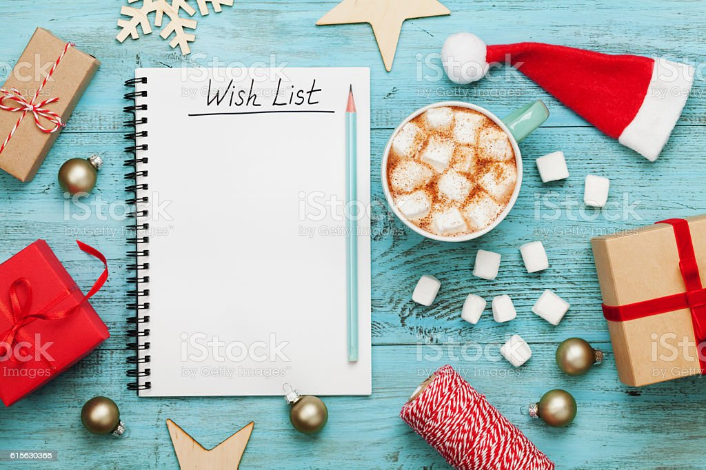 Cocoa or chocolate, holiday decorations and notebook, christmas planning concept. stock photo