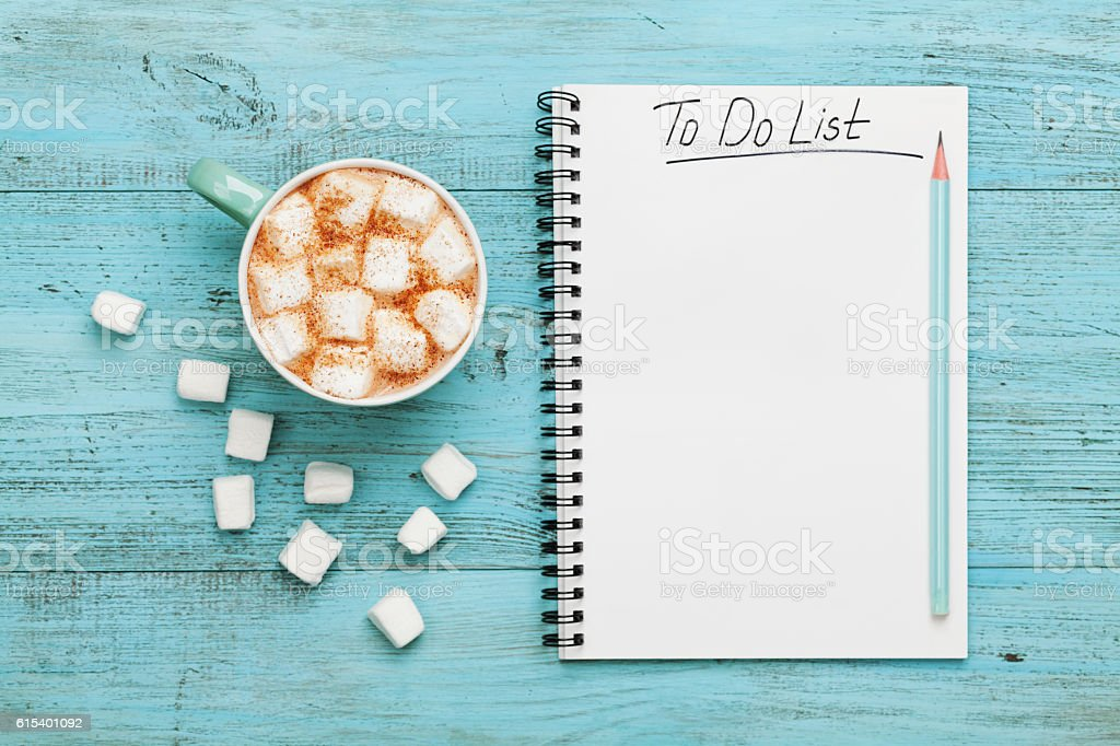 Cocoa or chocolate, notebook with to do list, planning concept stock photo