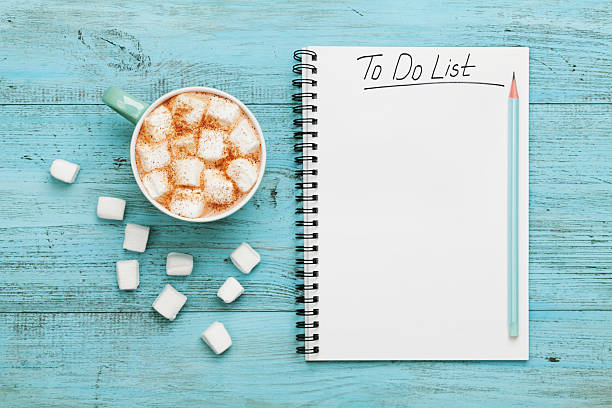 Cocoa or chocolate, notebook with to do list, planning concept - foto de acervo