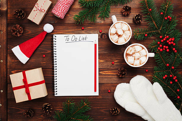 cocoa or chocolate with gifts, mittens, christmas fir tree, notebook. - liste photos et images de collection