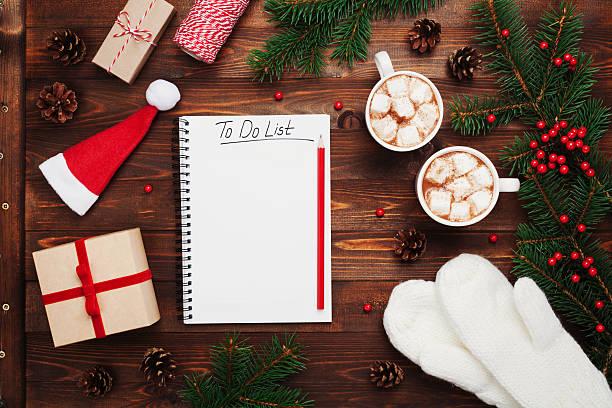 cocoa or chocolate with gifts, mittens, christmas fir tree, notebook. - weihnachts wunschliste stock-fotos und bilder