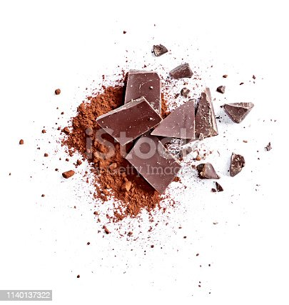 Cocoa powder and pieces of dark chocolate, isolated on white background. Cake ingredients, top view or high angle shot.