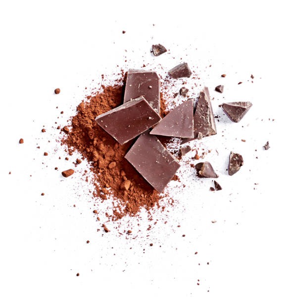 cocoa powder and pieces of dark chocolate - chocolate imagens e fotografias de stock