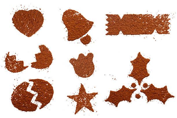 Cocoa powder dust in festive symbol shapes stock photo