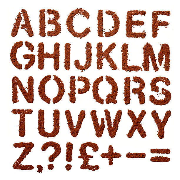 Cocoa powder dust Letters  alphabet and signs over white stock photo