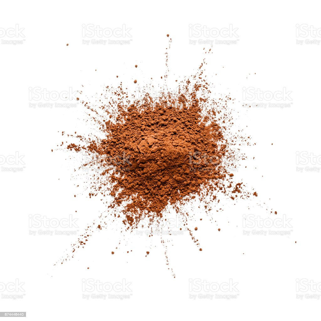 Cocoa powder heap shot from above on white bachground stock photo