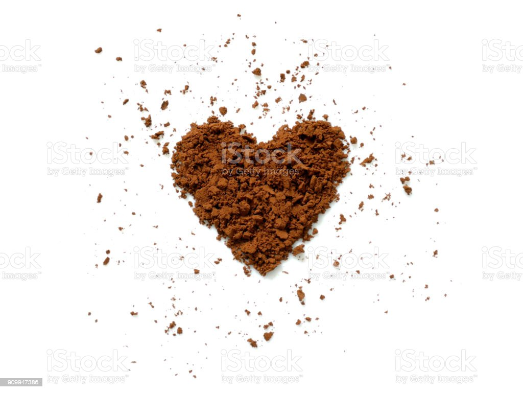 Cocoa powder spilling in heart shape stock photo