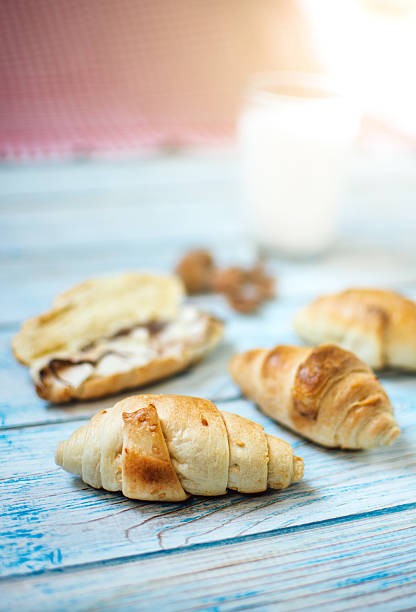 Cocoa spread, milk and croissant stock photo