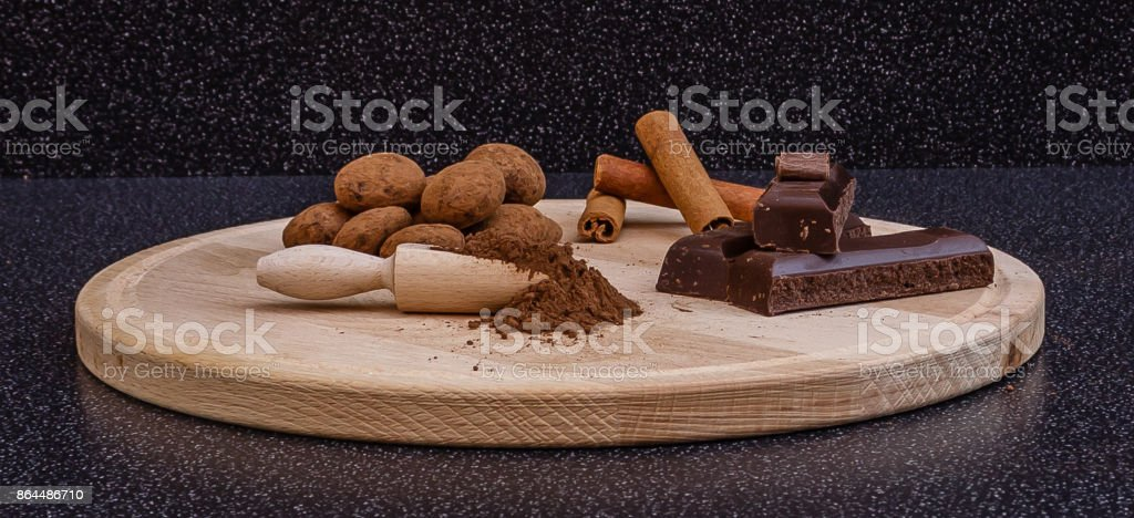 Cocoa truffles, cocoa powder,chocolate and cinnamon sticks stock photo