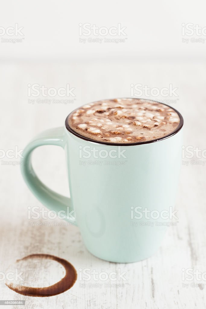 Cocoa wiht melted marshmallow in light blue cup stock photo