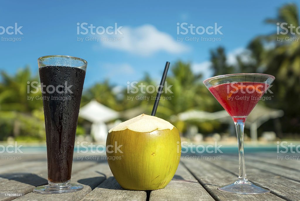 Coconut and cocktail on the beach royalty-free stock photo