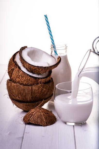 coconut and coconut milk - caraffa imagens e fotografias de stock