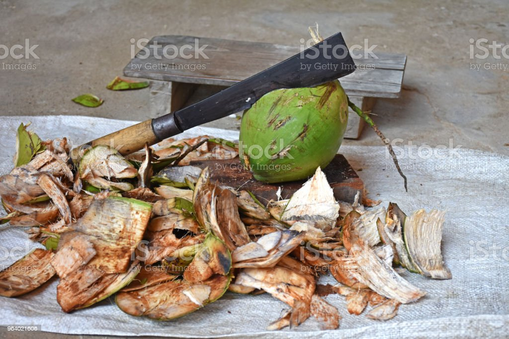 Coconut and coconut shell with chopping knife and small chair on concrete background - Royalty-free Abstract Stock Photo