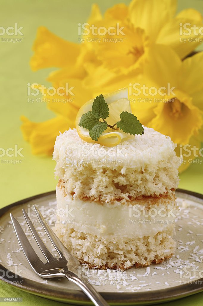 Coconut and lemon cream cake royalty-free stock photo