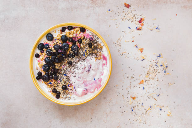 Coconut blueberry breakfast bowl with chia and sesame seeds stock photo