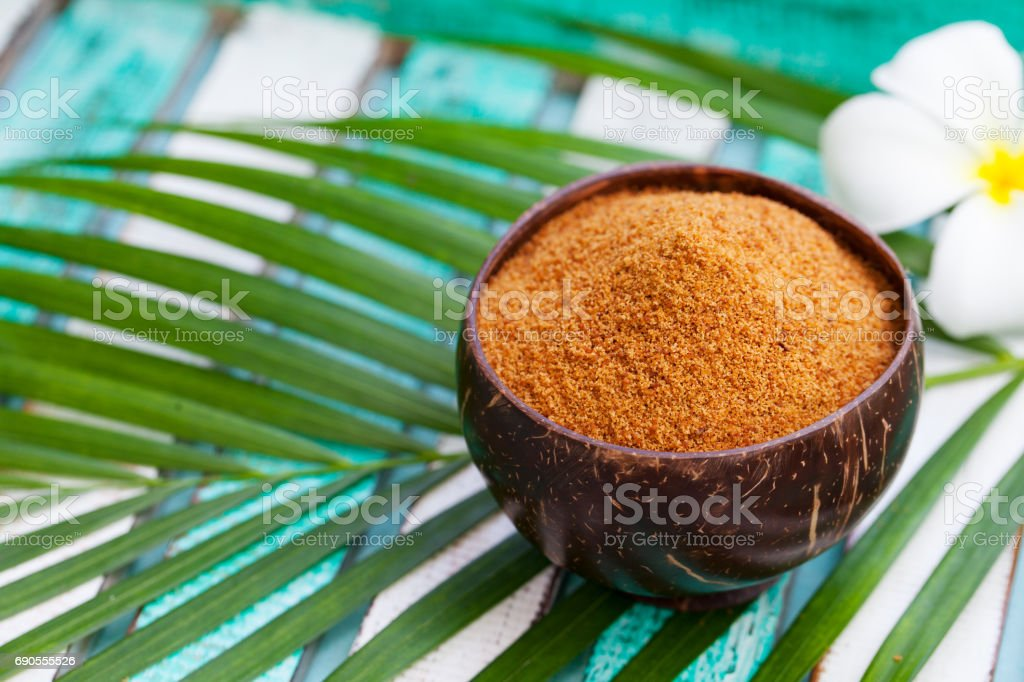 Coconut brown sugar in a wooden bowl. Copy space. stock photo