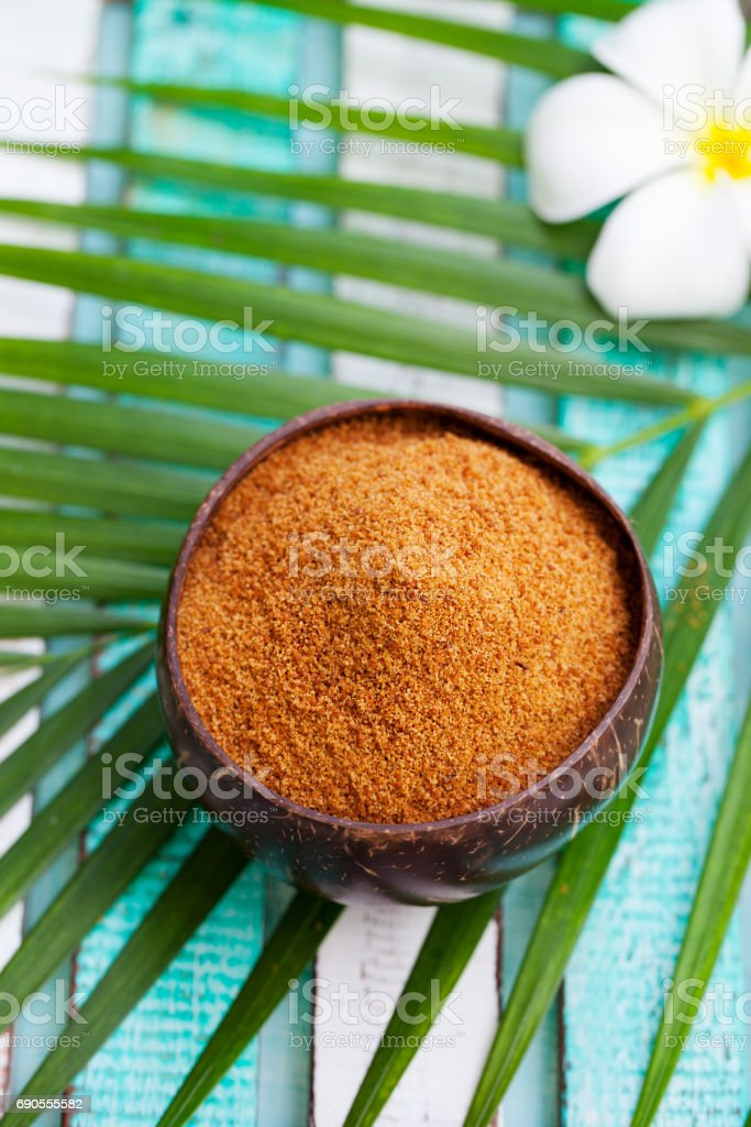 Coconut brown sugar in a wooden bowl. Top view. stock photo