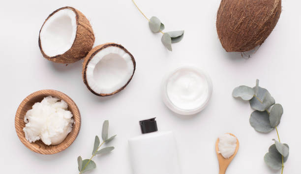 Coconut butter of natural components on white Natural spa cosmetics. Coconut butter of natural components on white background coconut oil stock pictures, royalty-free photos & images