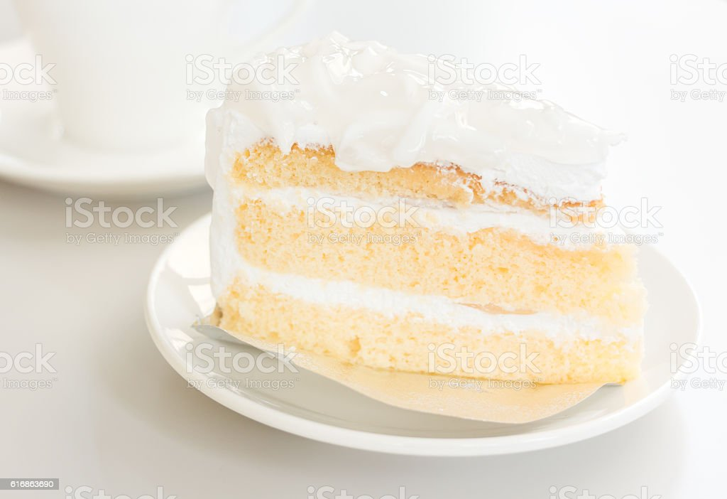 Coconut cake in white plate with coffee cup stock photo