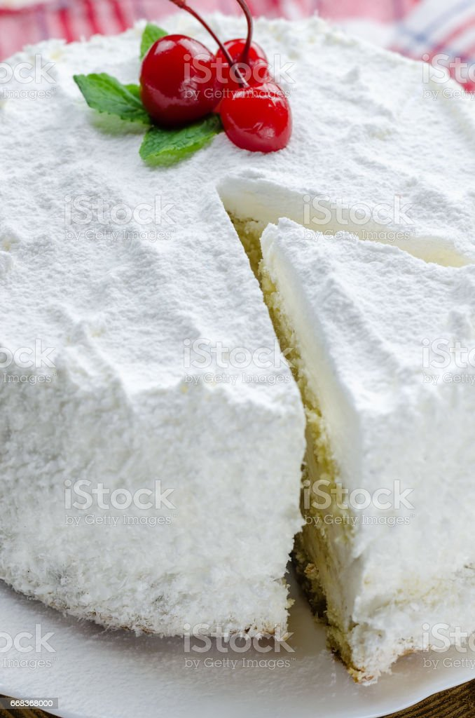 Coconut cake on white plate. - foto de acervo