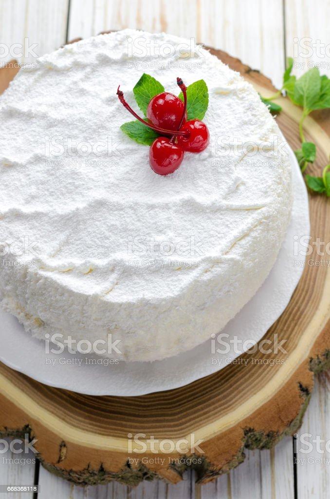 Coconut cake on wooden background. - foto de acervo
