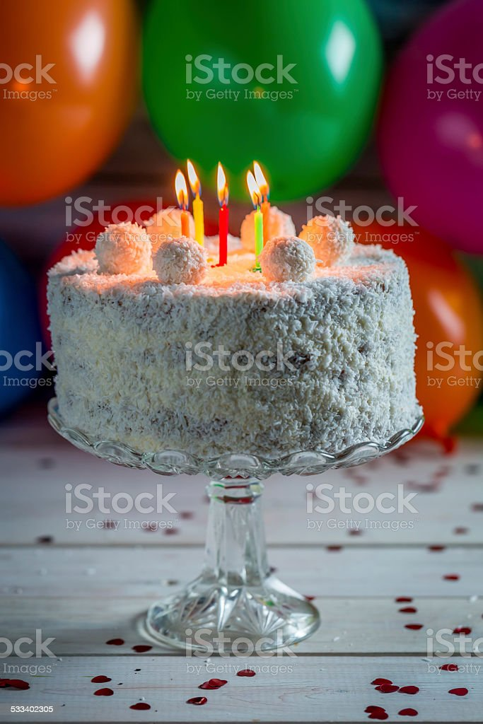 Coconut Cake With Candles On Birthday Stock Photo More Pictures Of