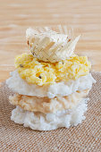 istock Coconut candy cocada with wicker hat on sackcloth 512936243