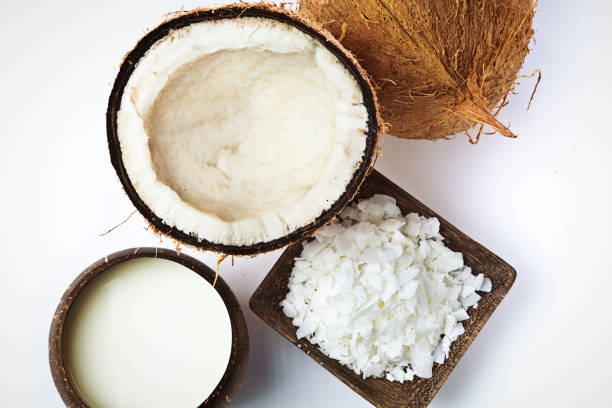 coconut, coconut cream milk and coconut flakes studio still life - coconut oil stock pictures, royalty-free photos & images