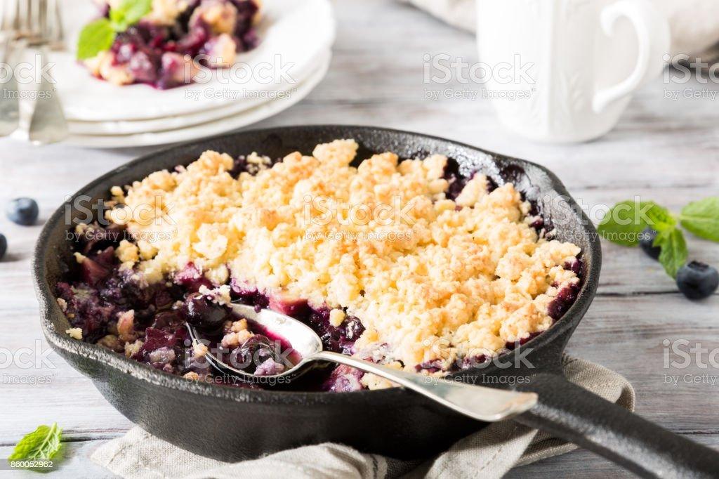 Coconut crumble in cast iron pan stock photo