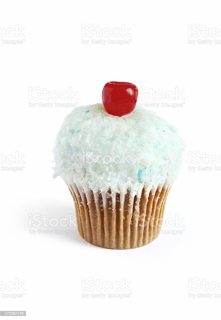 Coconut cupcake with cherry stock photo