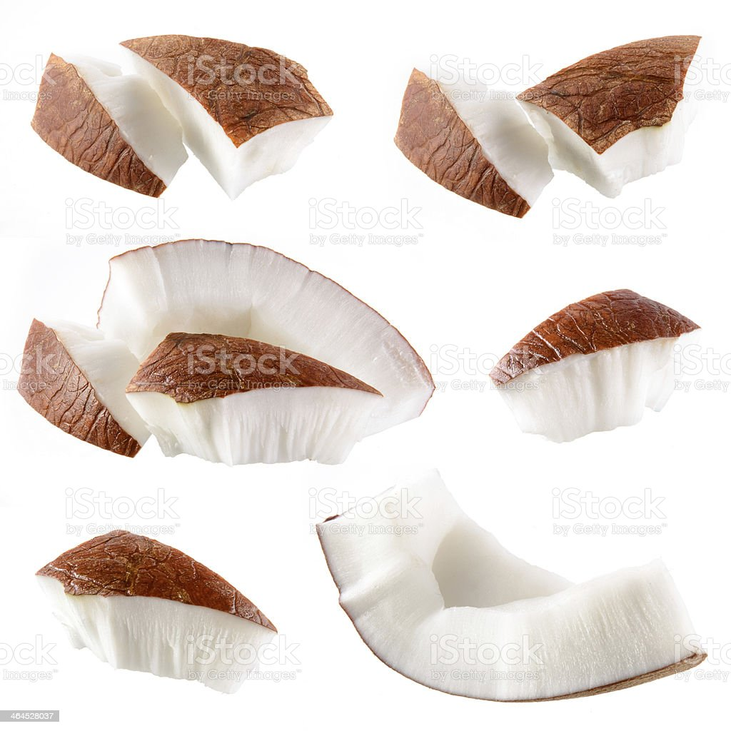 Coconut cut into jagged pieces on a white background stock photo