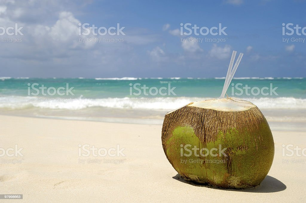 Coconut drink on exotic beach royalty-free stock photo