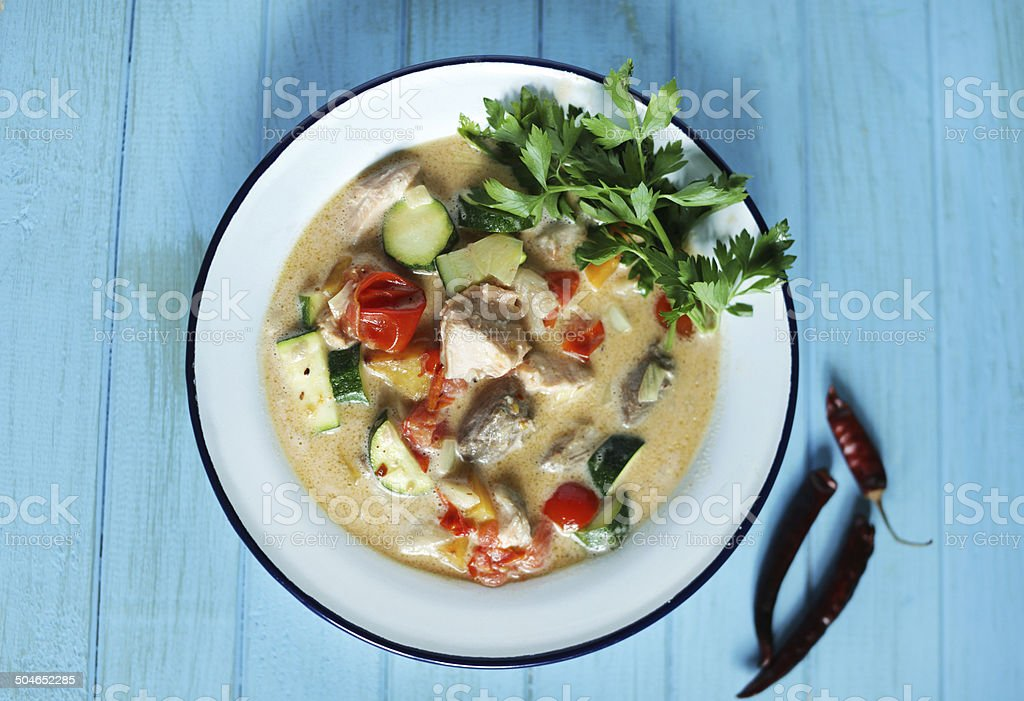 Coconut fish chowder with tuna, salmon and fresh vegetables stock photo