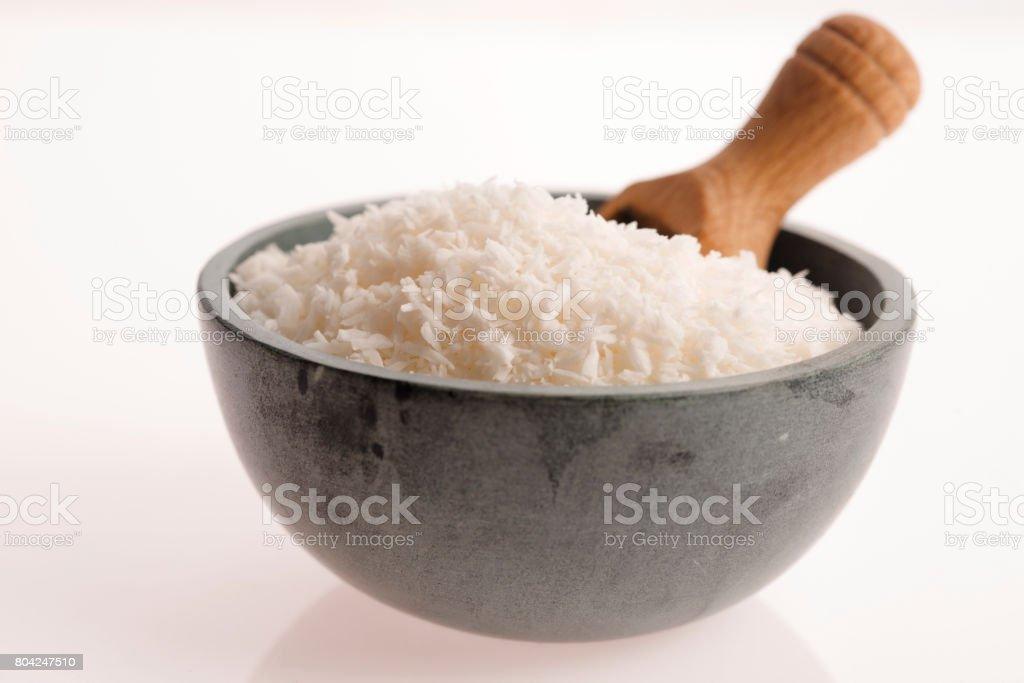 Coconut flakes in ceramic bowl stock photo