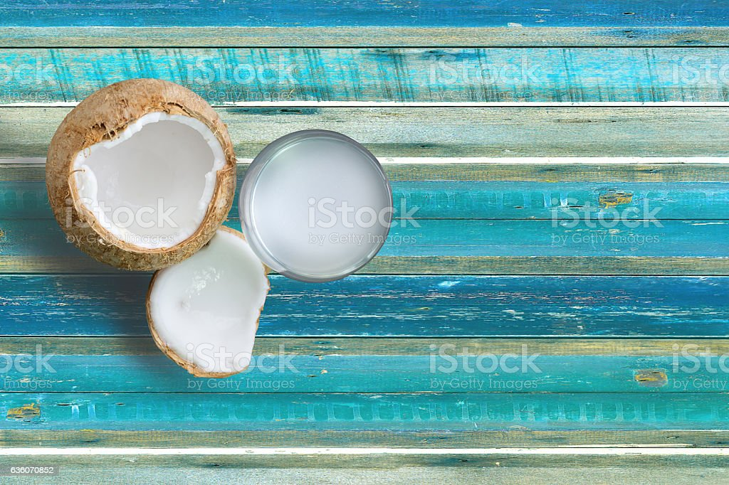 Coconut fresh water on vintage plank stock photo