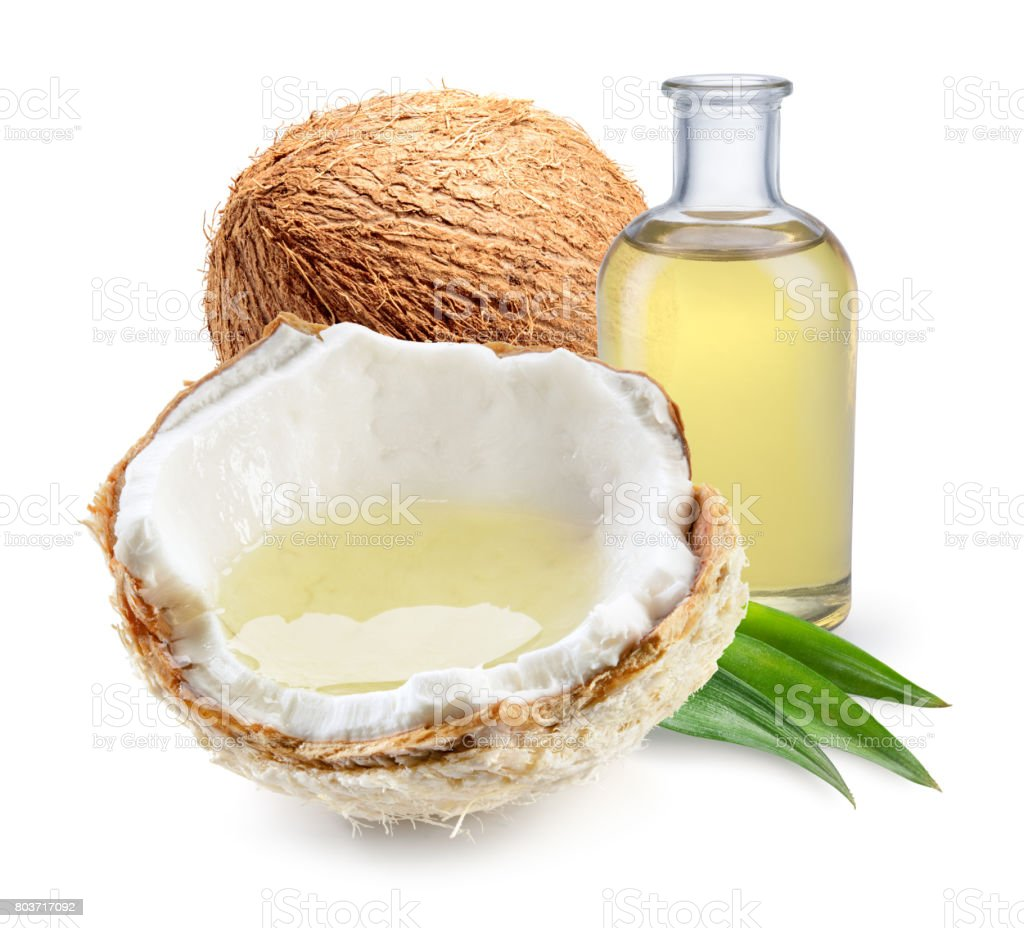 Coconut. Fresh young coconut with coconut oil isolated on white. stock photo