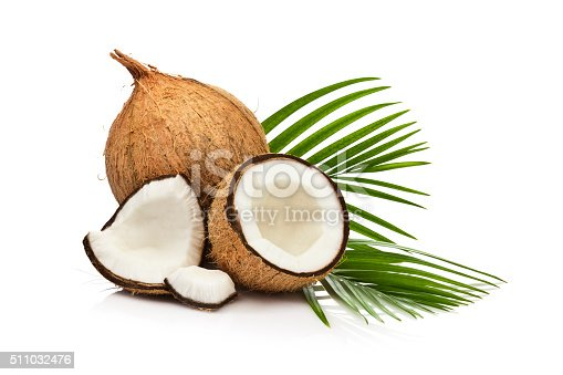 Coconut fruit and palm leaf isolated on white background