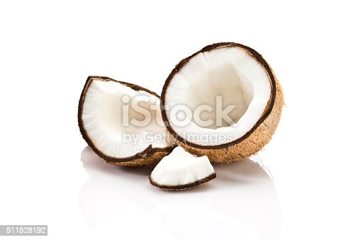 Cracked coconut fruit isolated on white background